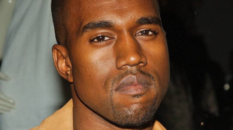 Kanye West poses at an event.