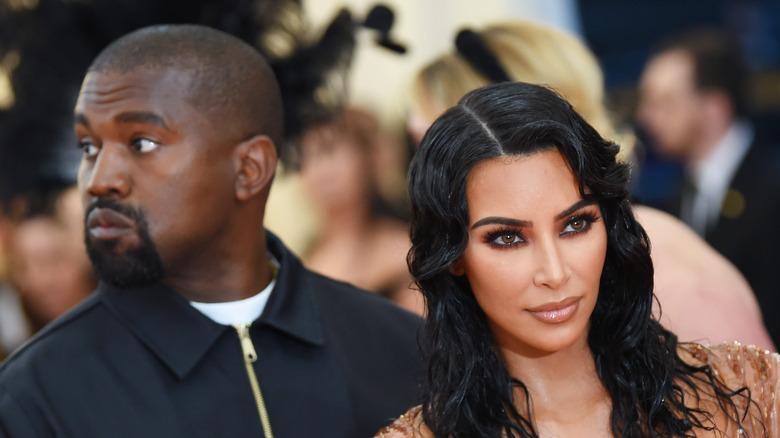 Kim Kardashian poses with Kanye West