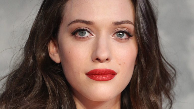 Kat Dennings with red lip and hair down