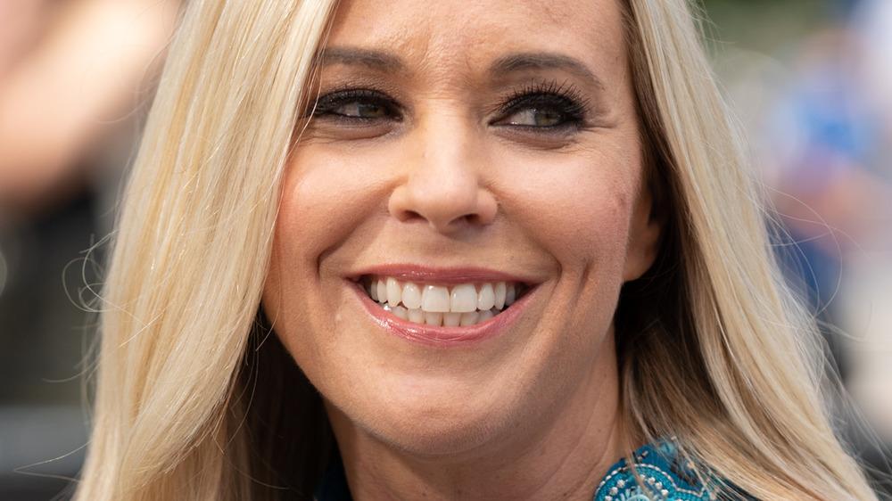 Kate Gosselin smiling in blue