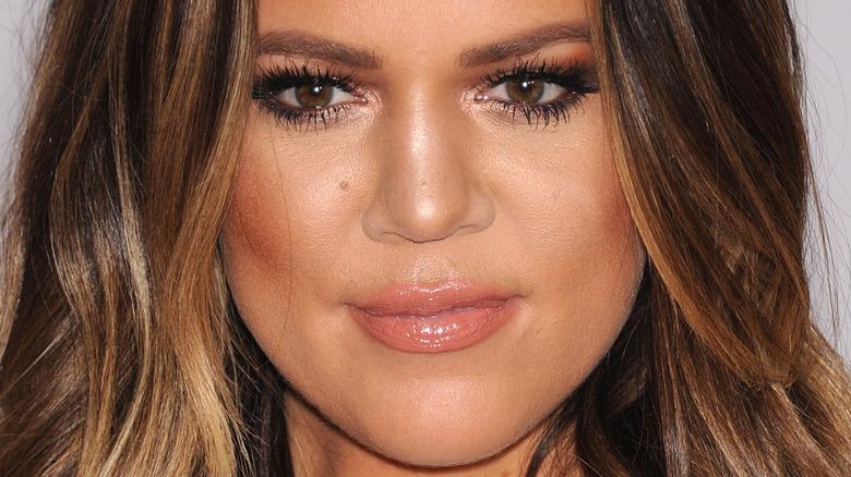 Khloé Kardashian smiles in a close up