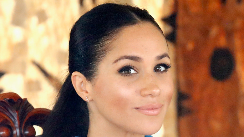 Meghan Markle looks at the camera
