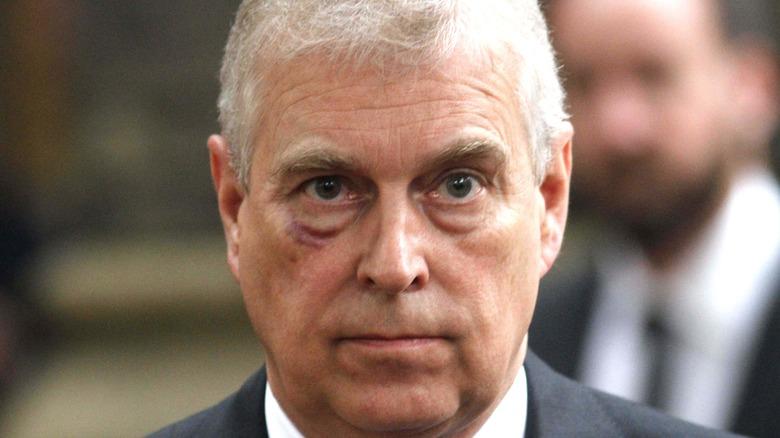 Prince Andrew looks sullen