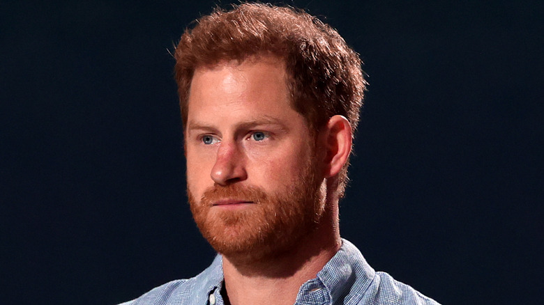 Prince Harry standing at event