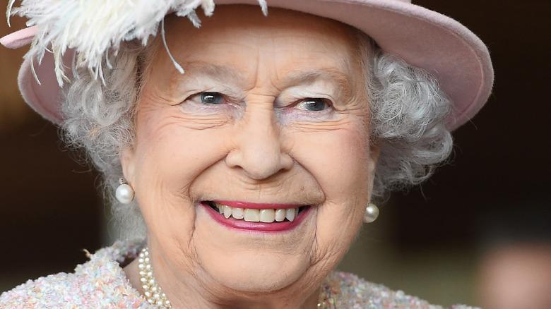 Queen Elizabeth in a pink hat
