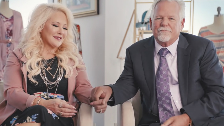 DeAnne and Mark Stidham holding hands