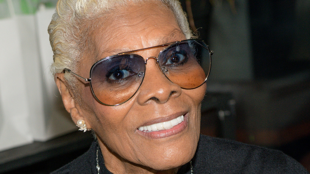 Dionne Warwick smiling in glasses