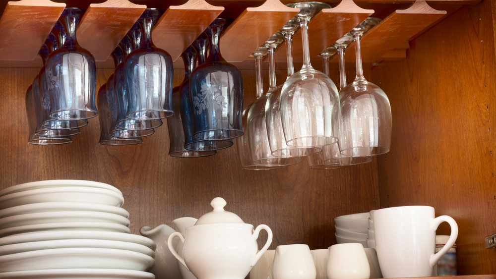 White plates and hanging glassware