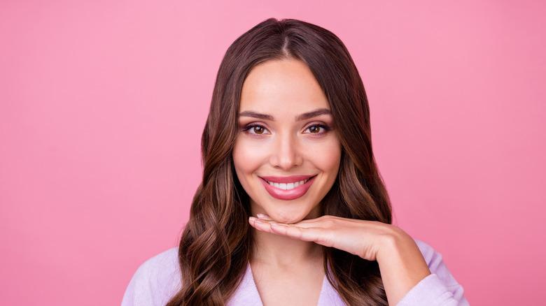 woman pink background jawline
