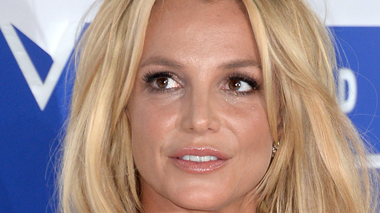 Britney Spears posing on the red carpet.