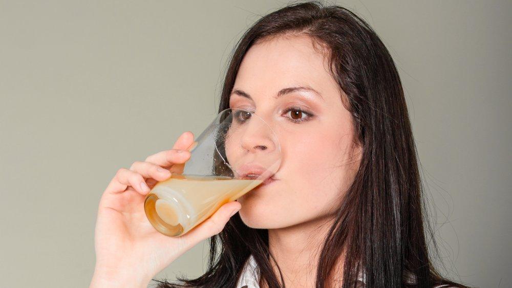 Woman drinking Emergen-C
