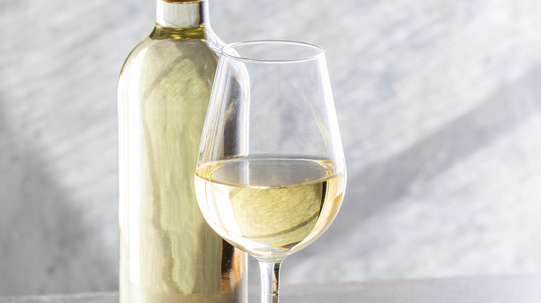 White wine in glass and bottle
