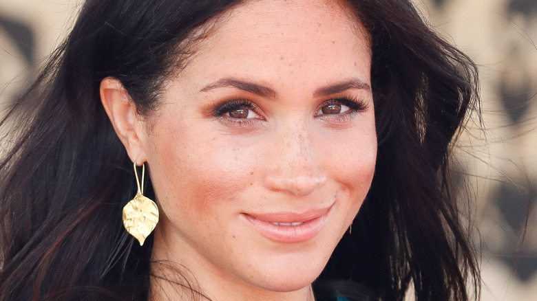 Meghan Markle smiles for the camera.
