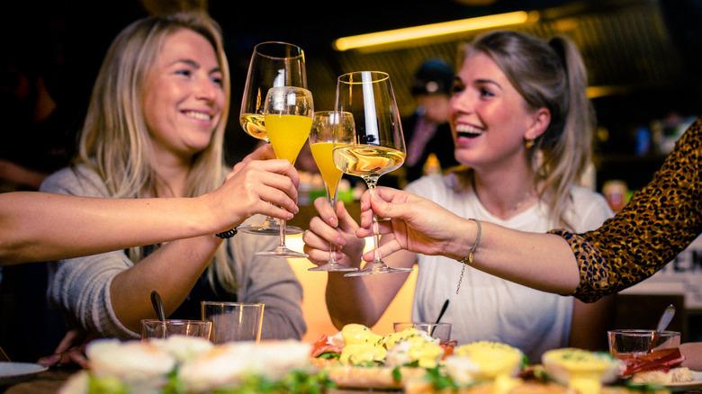 Girls smiling while drinking