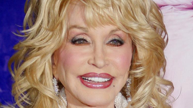 Dolly Parton big hair pink lipgloss