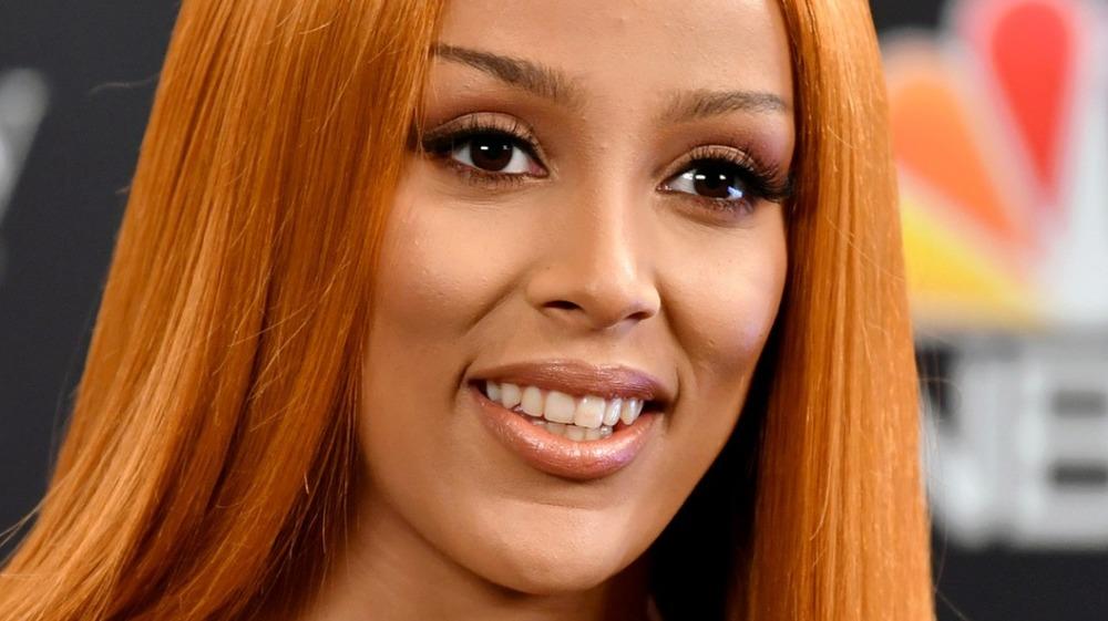 Orange haired Doja Cat smiling