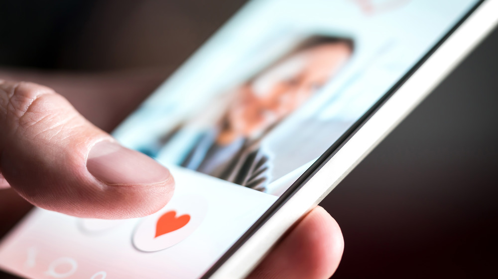 Person using phone dating app