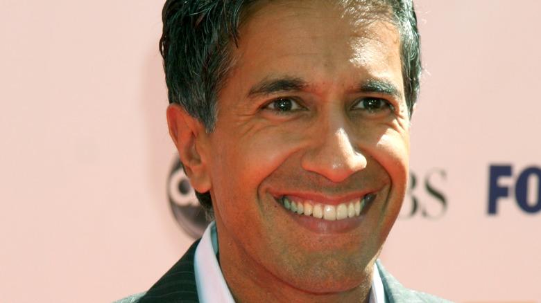 Dr. Sanjay Gupta smiling on red carpet