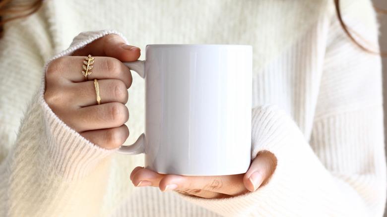 Woman holding a mug of coffee