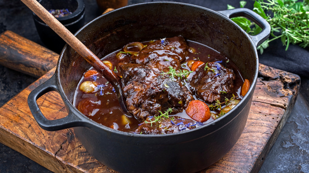 A Dutch oven with stew inside