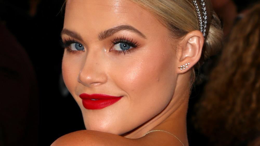 Witney Carson wears red lipstick