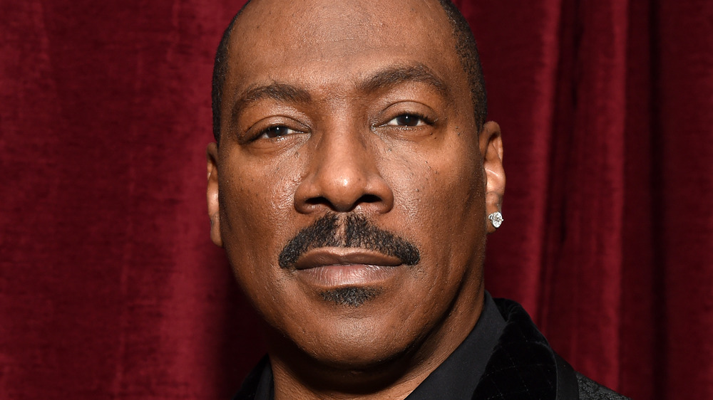 Eddie Murphy poses at an event