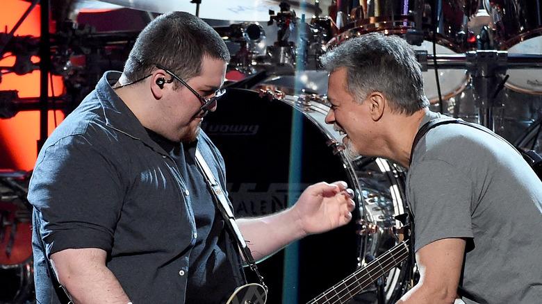 Eddie and Wolfgang Van Halen performing on stage