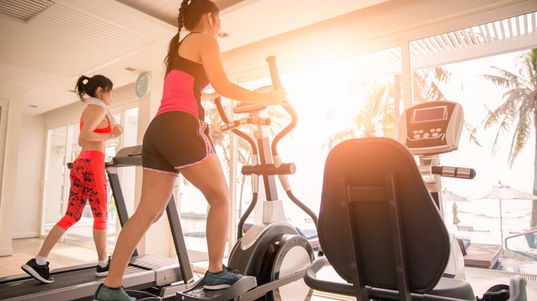 Women using cardio machines