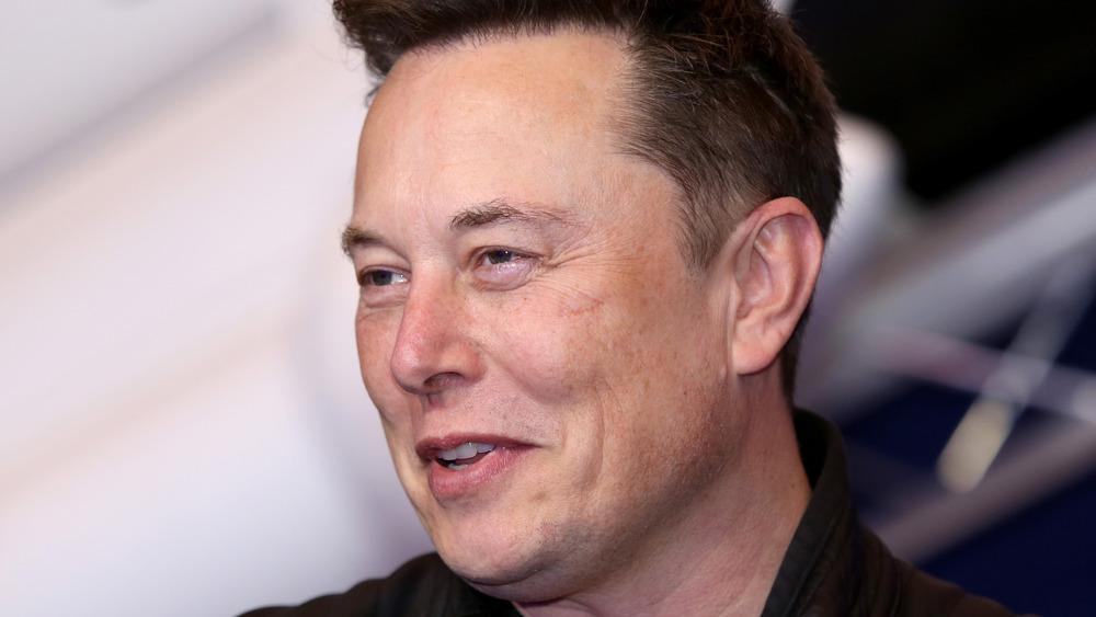 Elon Musk smiling while speaking