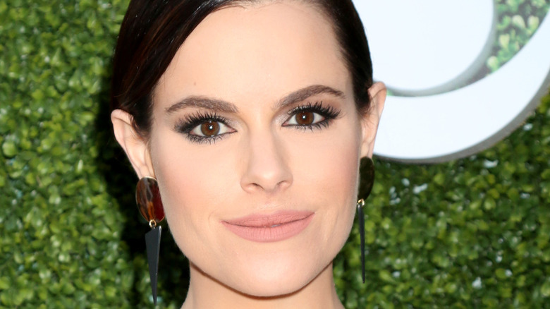 Emily Hampshire poses on the red carpet