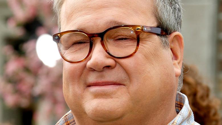Close up of Eric Stonestreet wearing glasses