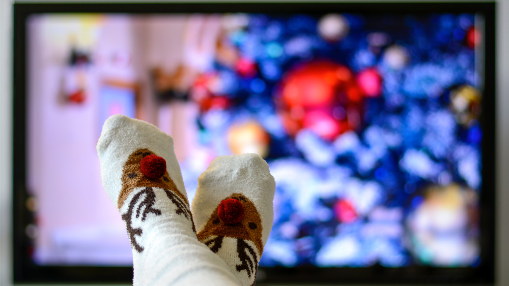 Person watching Christmas movie