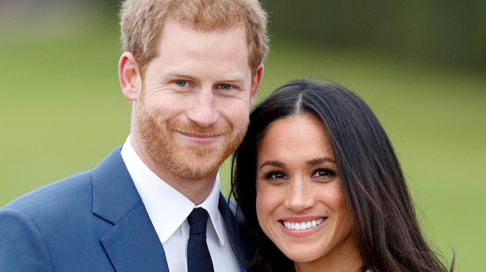 Prince Harry and Meghan Markle smile