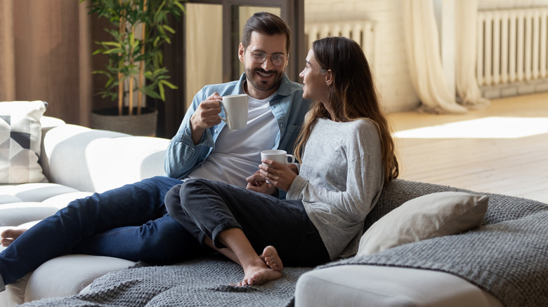 couple drinking coffee on couch