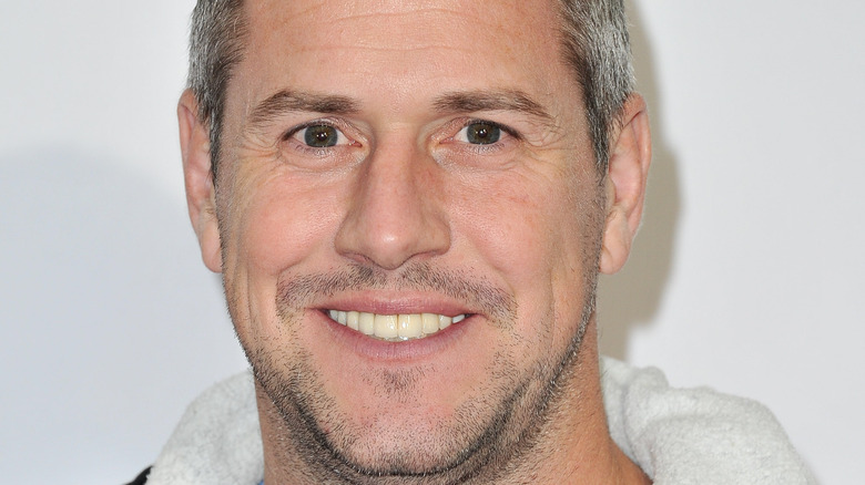 Ant Anstead smiles with a thin mustache