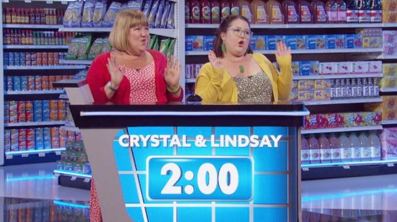 Supermarket Sweep contestants celebrating