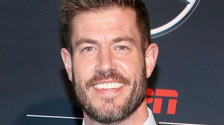 Jesse Palmer poses at an event
