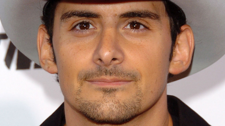 Brad Paisley smiling in a cowboy hat