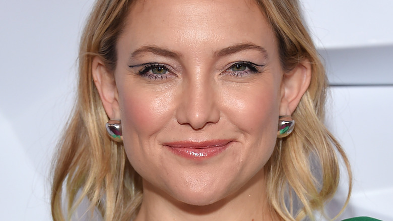 Kate Hudson grinning mouth closed