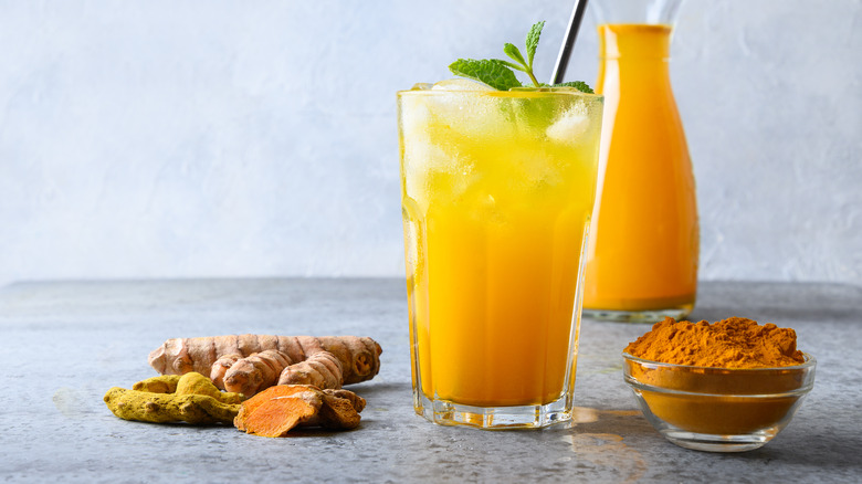 Jamu juice surrounded by ingredients