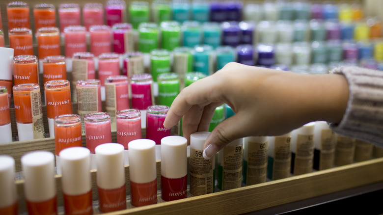 A customer selects nail polish from an Innisfree store.