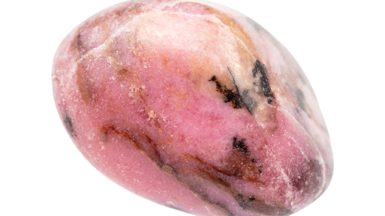 A piece of rolled rhodonite