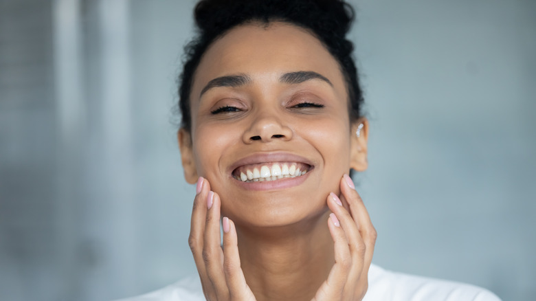 Woman smiling with glowing skin