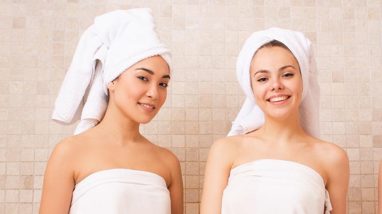 Women wearing towels in a bathhouse