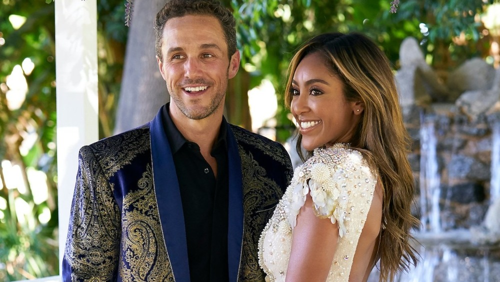 Tayshia Adams and Zac Clark smiling