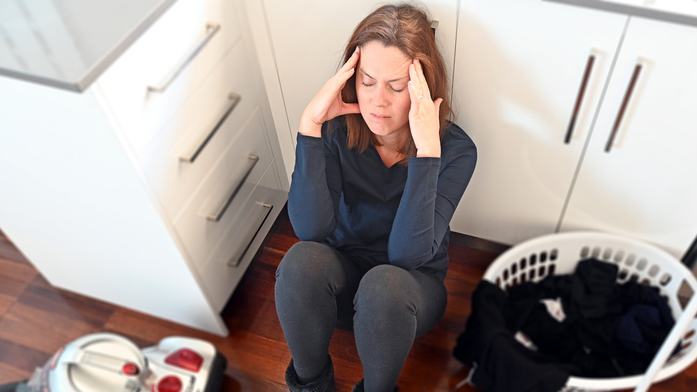 Frustrated woman cleaning