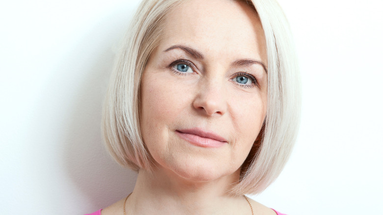 older woman with thin eyebrows