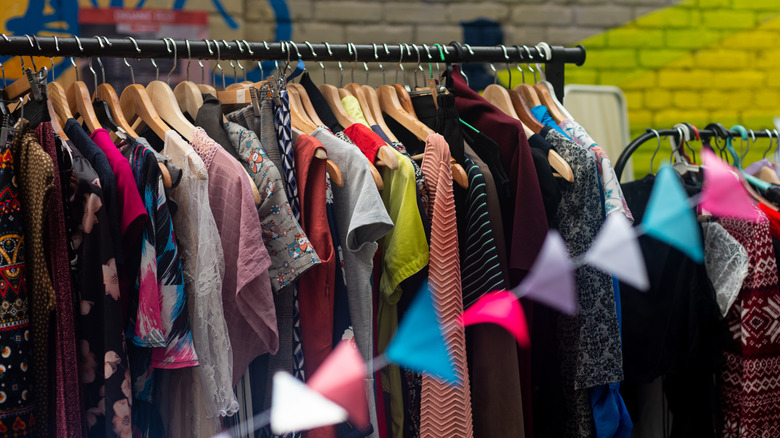 colorful second hand clothes on hangers