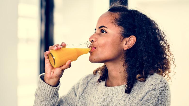 A woman drinking juice