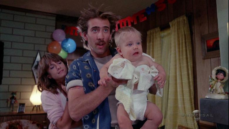 Nicolas Cage holding a baby in Raising Arizona